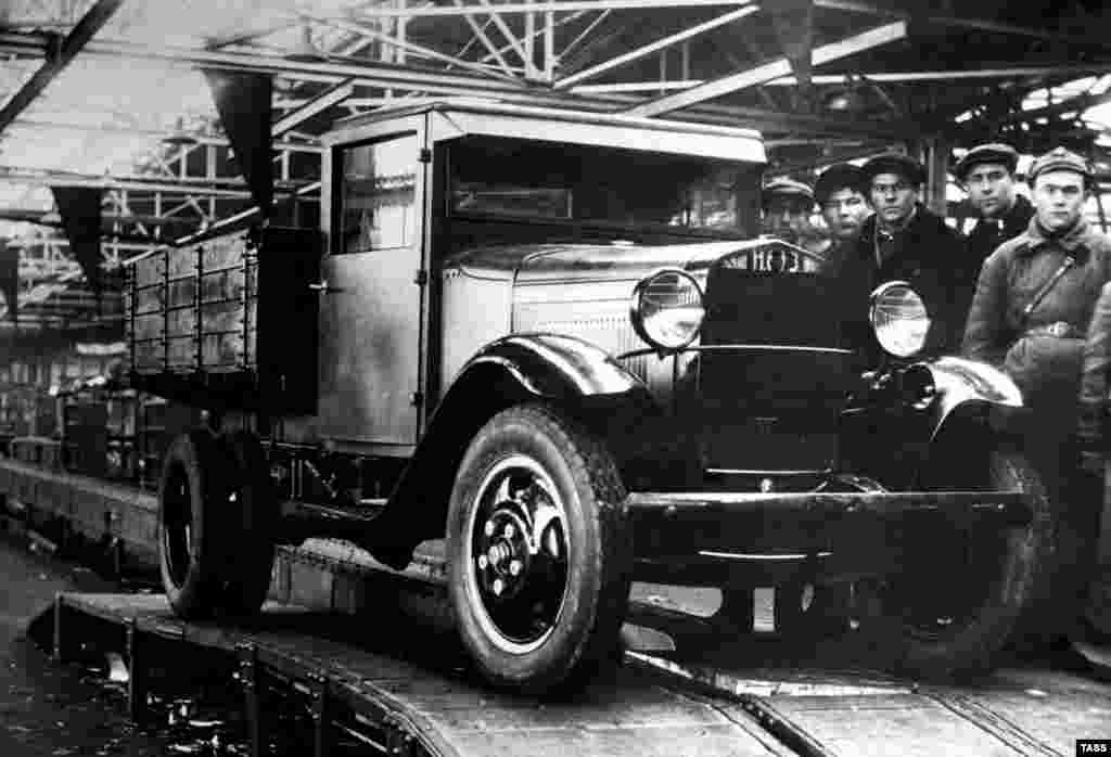The first truck to roll off the assembly line of the U.S.S.R's GAZ automobile factory in 1932. Three years earlier, American industrialist Henry Ford signed a contract with the fledgling Soviet Union to set up the plant in Russia. The factory would turn out licensed copies of Ford cars and trucks like this GAZ-AA.