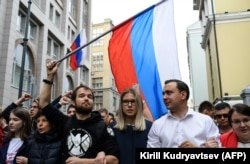 Candidates Lyubov Sobol (center) and Ivan Zhdanov (right) attend a rally against efforts to stop opposition candidates from registering for elections to the Moscow City Duma in central Moscow on July 14.