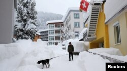 Heavy snowfall has arrived on the eve of the World Economic Forum in Davos, Switzerland.