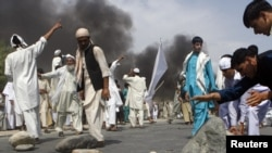 Protesters tried to set up makeshift barricades Nangarhar Province on September 10, the first day of Afghan demonstrations against the Florida pastor's Koran-burning plans.