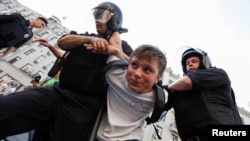 The authorities seemed to pay particular attention to young people, such as this teen who was detained by police in Moscow on September 9.