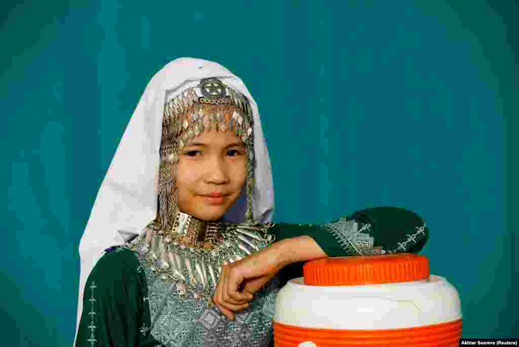 A girl in traditional finery during Hazara Culture Day in Quetta on June 21, 2019.