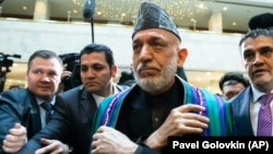 "Former Afghan President Hamid Karzai (center) arrives for ""intra-Afghan"" peace talks in Moscow on February 5."