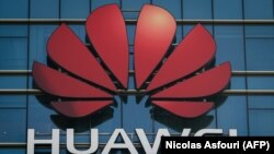 The Huawei logo stands on a Huawei office building in Dongguan in China's southern Guangdong province, December 18, 2018
