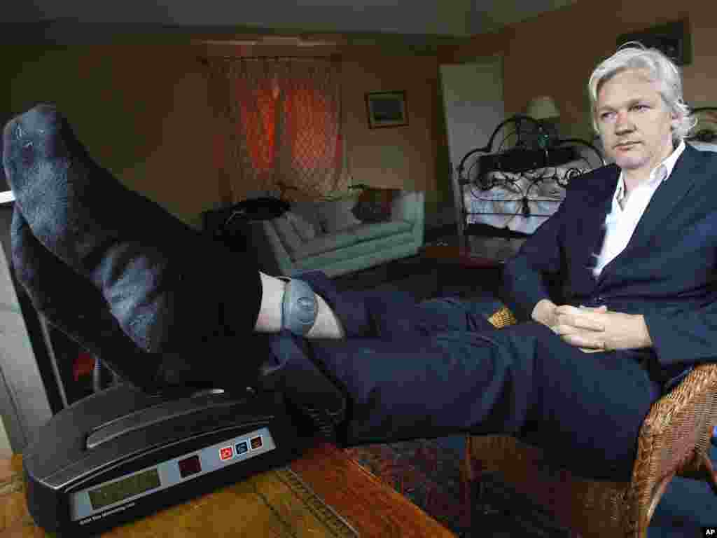 WikiLeaks founder Julian Assange is seen with his ankle security tag while under house arrest near Bungay, England, on June 15. Photo by Kirsty Wigglesworth for AP