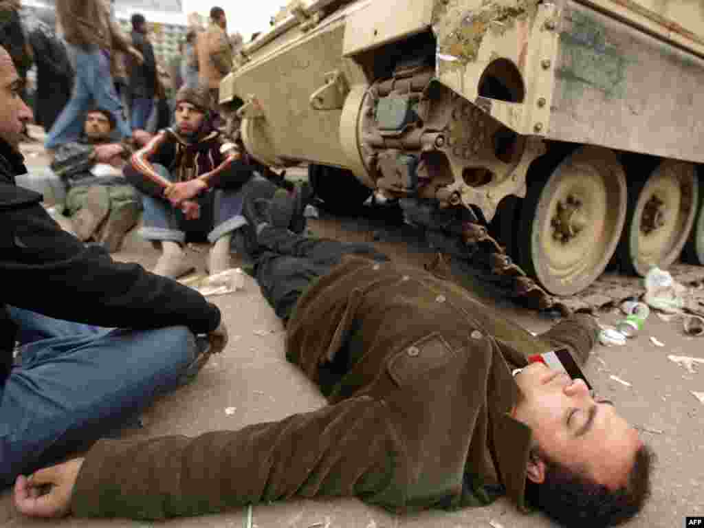 Protesters block one of the army's armored personnel carriers from pulling out of Tahrir Square on February 5.