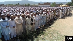 Supporters and local residents offer funeral prayers for provincial lawmaker Farid Khan, who was killed in an attack by Taliban gunmen, in Hangu in Khyber Pakhtunkhwa Province on June 4.