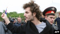 A Russian police officer arrests a participant in the gay rights protest in Moscow.