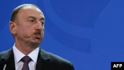 Azerbaijan's President Ilham Aliyev attends a press conference following a meeting with German Chancellor Angela Merkel at the Chancellery in Berlin on January 21.