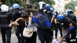 Turkey -- Demonstrators are detained by Turkish police officers during a protest condemning a suicide bombing on July 25, 2015 in Ankara.