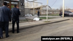 The body of the Russian soldier, who was found with stab wounds to his neck, in Gyumri on April 22