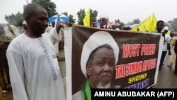 Protesters from the pro-Iranian Islamic Movement in Nigeria (IMN) holds a banner with a photograph of detained leader Ibrahim Zakzaky to press for his release in northern Nigerian city of Kano, on August 11, 2016.