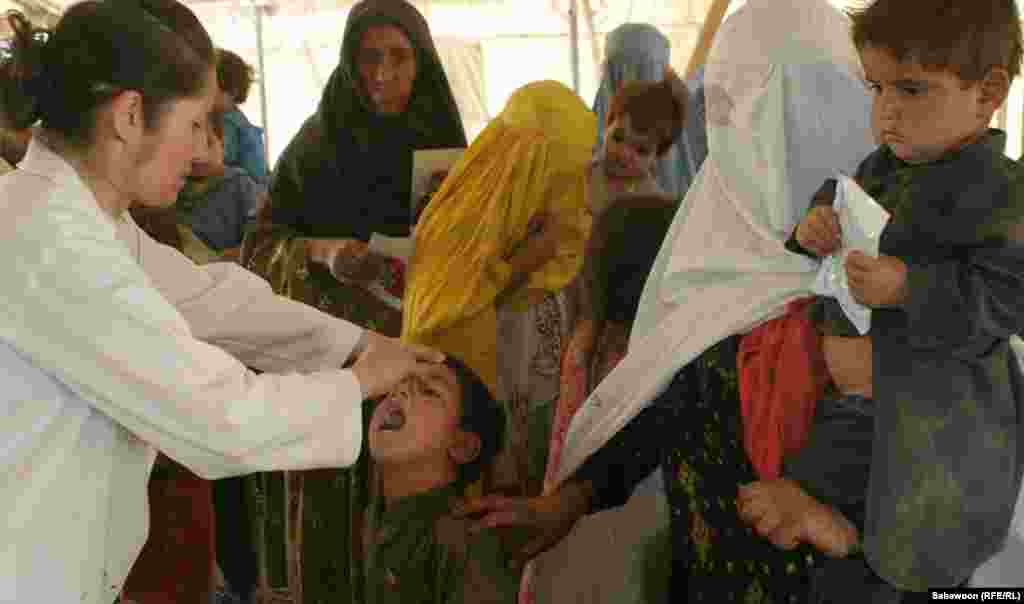 A doctor administers vaccines to children at a hospital in Kabul.