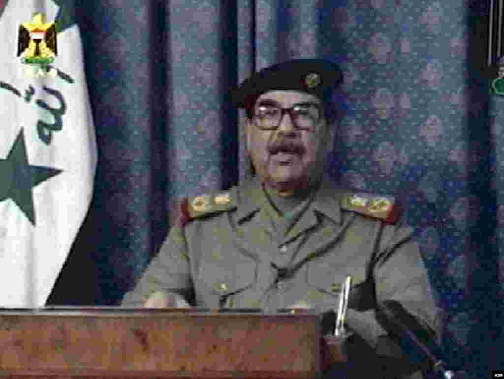 A defiant Saddam Hussein appears on state television, three hours after the United States launched a war to overthrow him, on March 20, 2003.