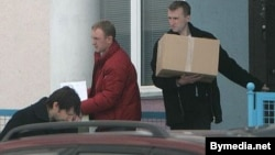 Police seize computers and other materials from Radio Racyja's offices in Minsk.