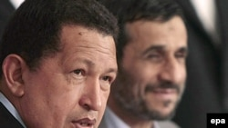 "Iranian President Mahmud Ahmadinejad (right) with his Venezuelan ""buddy,"" Hugo Chavez"