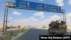 Residents of Idlib Province flee toward the Syrian-Turkish border on September 10.