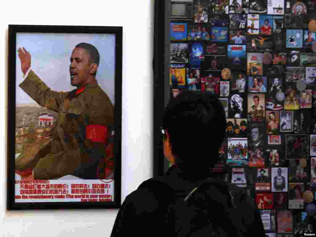 A visitor looks at a work on display showing the head of U.S. President Barack Obama superimposed onto the body of former Chinese chairman Mao Zedong in Beijing. (REUTERS/David Gray)