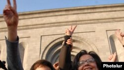 Prominent human rights activist Shirin Ebadi (left) joins an opposition protest in Yerevan.