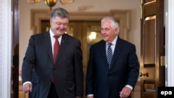 U.S. Secretary of State Rex Tillerson (right) meets with Ukrainian President Petro Poroshenko at the Department of State in Washington on June 20.