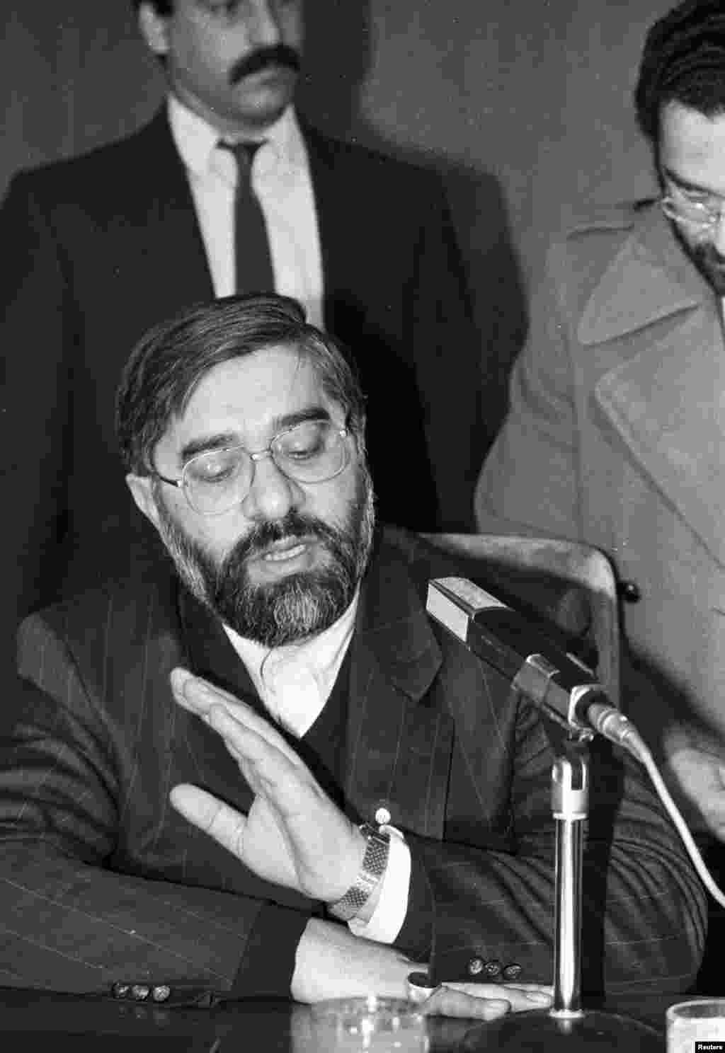Iranian Prime Minister Mir-Hossein Musavi answers questions about the Rushdie fatwa during a press conference at Ankara airport in February 1989, shortly after Khomeini declared the death sentence. (REUTERS/Fatih Saribas)