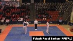 جانب من منافسات البطولة العربية العسكرية بالتايكواندو في الأردن.