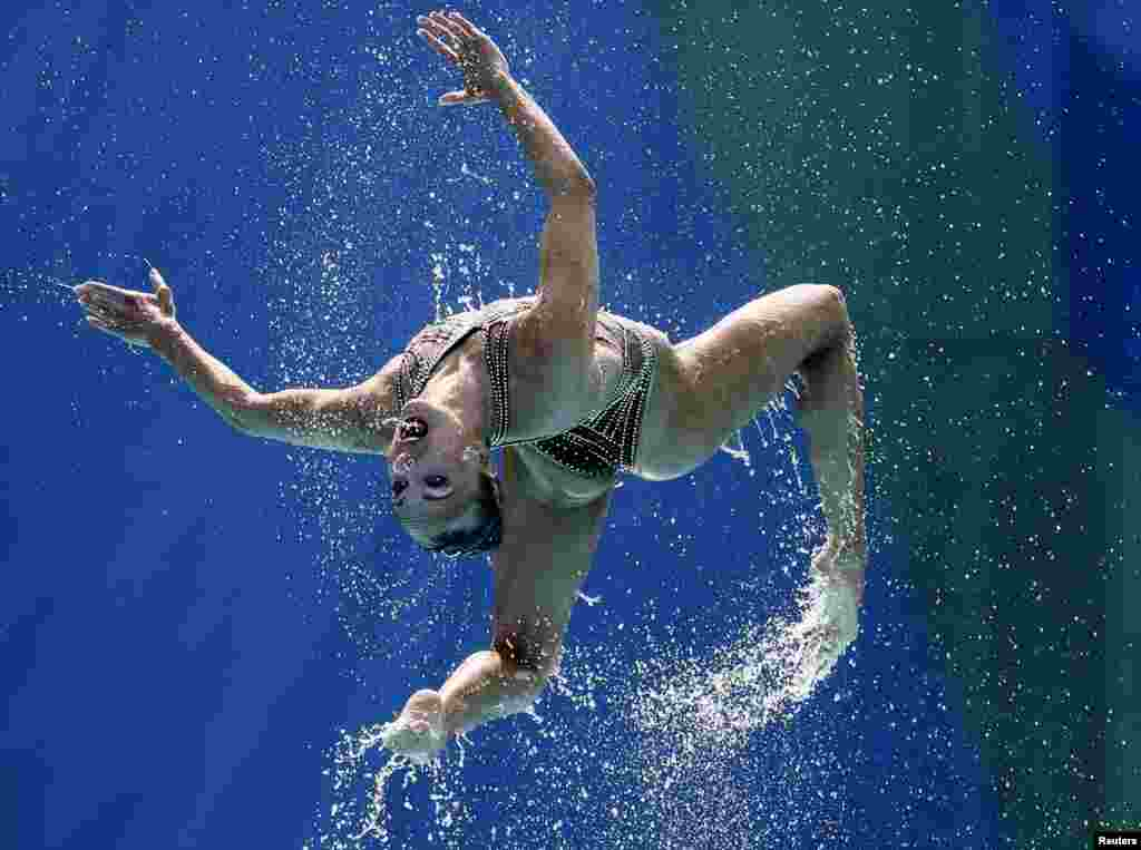 An athlete from the Russian synchronised swimming team during the technical routine final.