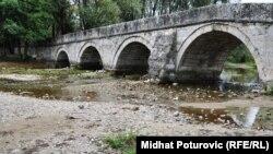 A bridge spans the Bosna River in Bosnia in September.