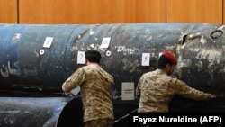 SAUDI ARABIA -- Saudi soldiers reveal the remains of missiles, that a military coalition led by Saudi Arabia claim are Iranian during a press conference at the Armed Forces club in Riyadh, March 26, 2018