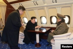 Kim inside the jet, where a glass ashtray confirms smoking is tolerated.