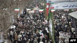 "Iran -- Massive crowds of people, waving national flags and chanting ""Death to Mubarak!"" and ""Death to America!"" descend on Tehran's Azadi Square, 11Feb2011"