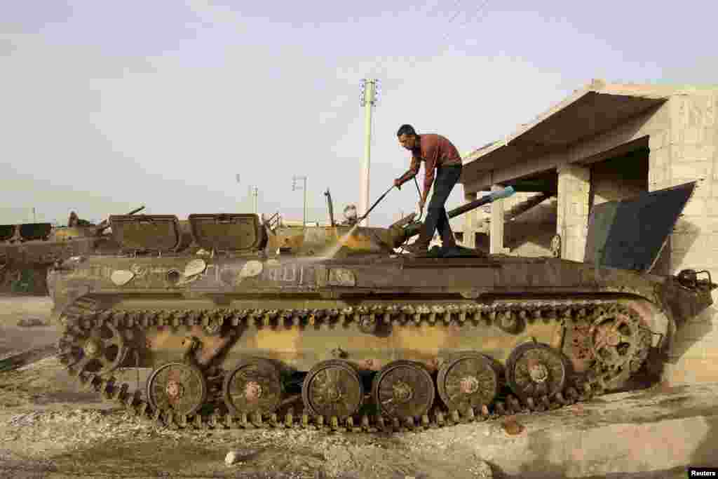 A man washes a tank in Azaz near Aleppo, Syria. (Reuters/Muzaffar Salman)