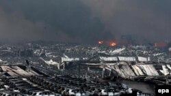 Тяньцзинь қаласындағы жарылыстан кейінгі көрініс. Қытай, 13 тамыз 2015 жыл.