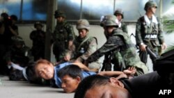 Antigovernment protesters are detained by soldiers inside their camp in Bangkok on May 19.
