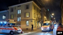 Ambulances and police cars are seen outside a Muslim prayer hall in central Zurich on December 19 after three people were injured by gunfire.