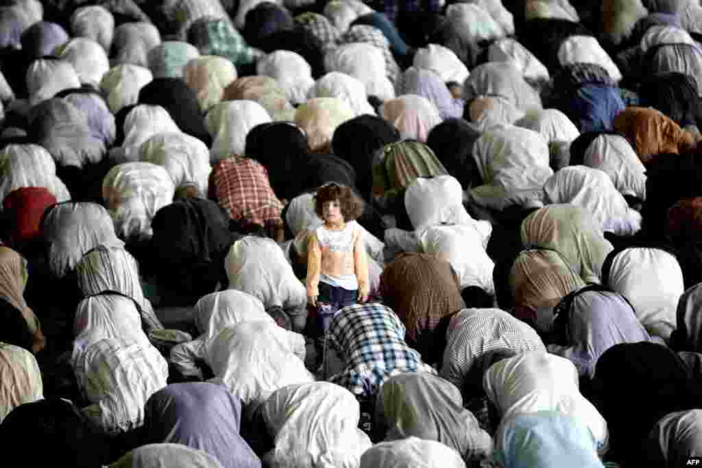 A girl stands among worshipers during Friday Prayers at Tehran University in Iran. (AFP/Behrouz Mehri)