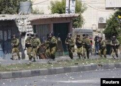 Ізраїльські солдати під час зіткнень з палестинцями в місті Хеврон. 13 жовтня 2015 року