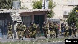 Policia e Izraelit gjatë përleshjeve me demonstruesit palestinezë