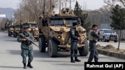 Foreign security personnel and Afghan police arrive at the site of the attack in Kabul on March 6.