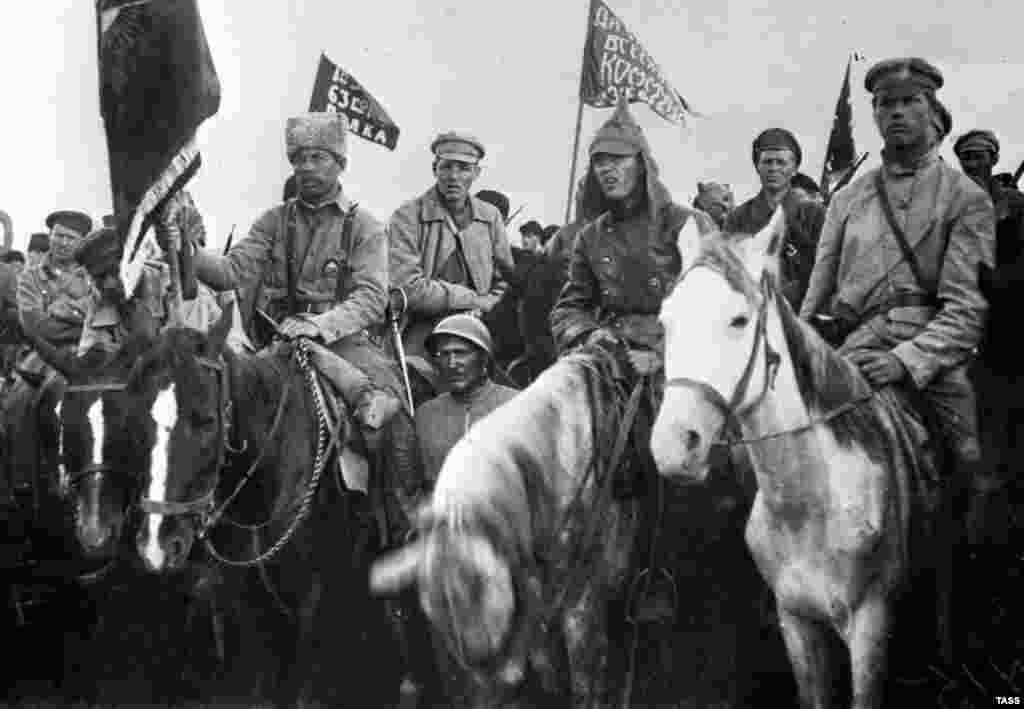 A motley lineup of hat- and helmet-wearing communists at a rally in 1920. Although there is debate over its origins, most Russian historians today agree that the cone-like cap was initially produced for the tsar's army.