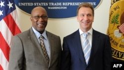 U.S. Trade Representitive Ron Kirk (left, with Russian Deputy Prime Minister Igor Shuvalov) said repealing the Jackson-Vanik amendment would ensure that U.S. companies will benefit from Russia's entry into the World Trade Organization.