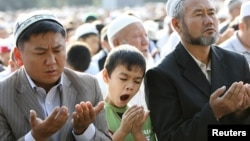 A boy yawns during Islamic prayers at a square in the Kyrgyz capital, Bishkek.