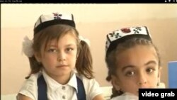 Sughd education officials recomend Tajik pupils to wear national hates - toqi, photo from Sm-1 TV video in Youtube