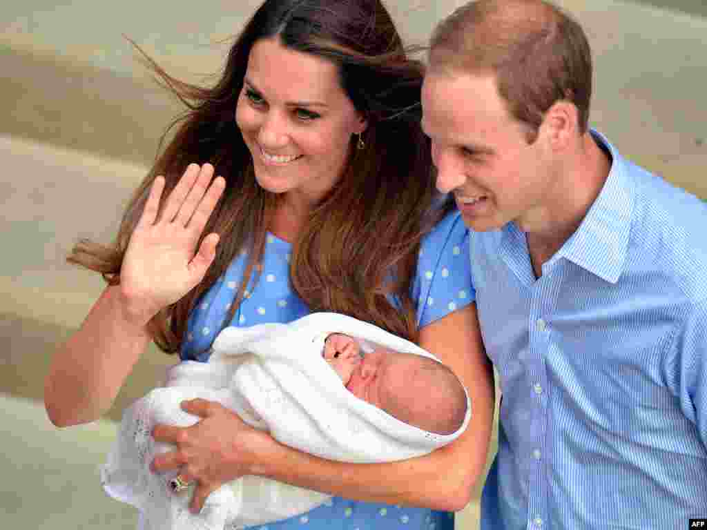 Prince William and Catherine, duchess of Cambridge, show their newborn baby boy to the world's media outside the Lindo Wing of St. Mary's Hospital in London. The baby is third in line to the throne. (AFP/John Stillwell)