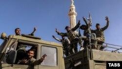 """Пальмираны """"Ислам мамлекети"""" террордук тобунан бошоткон Сирия армиясы."""