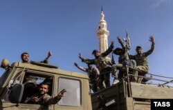 Солдаты армии Асада на улице Тадмура. 28 марта 2016 года