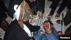 Родные и друзья убитого силами безопаности жителя Хоулы