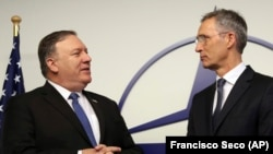 U.S. Secretary of State Mike Pompeo (left) and NATO Secretary-General Jens Stoltenberg prior to a meeting of the alliance's foreign ministers in Brussels on December 4.