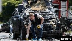 На месте взрыва машины Максима Шаповала. Киев, 27 июня 2017
