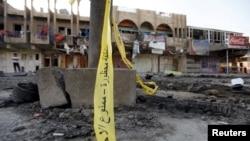 آثار تفجير وقع في بغداد في 23 تموز